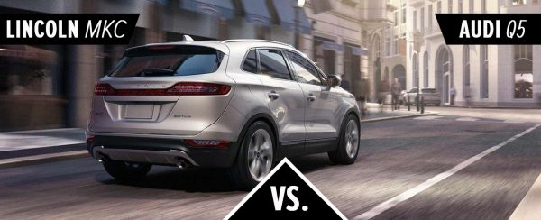 The 2018 Lincoln MKC driving down the street.