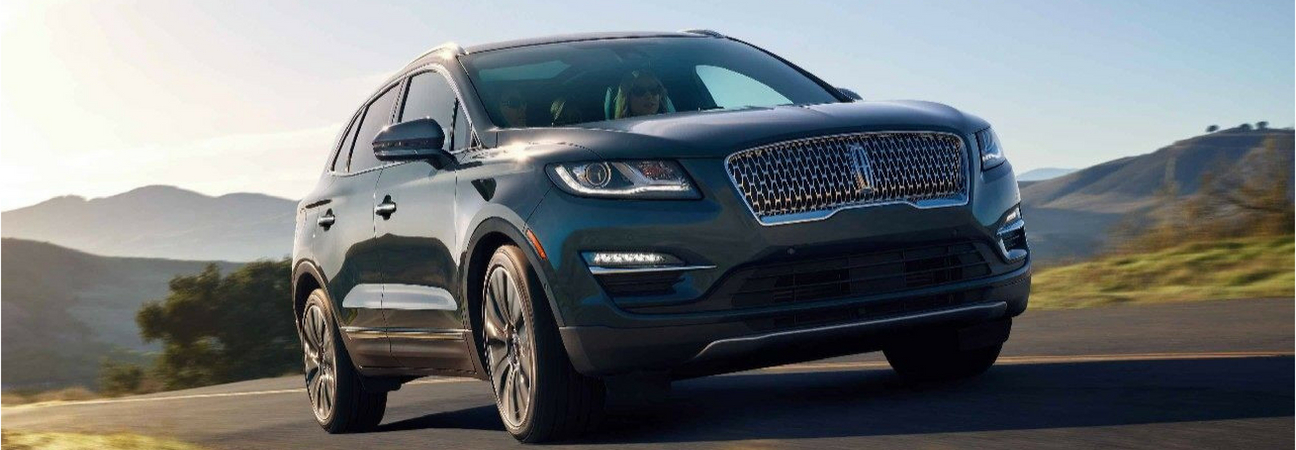 Charcoal 2019 Lincoln MKC cruising a country road