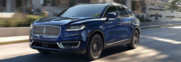 Blue 2019 Lincoln Nautilus driving through city streets