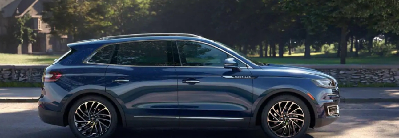 Blue 2019 Lincoln Nautilus parked on side of street